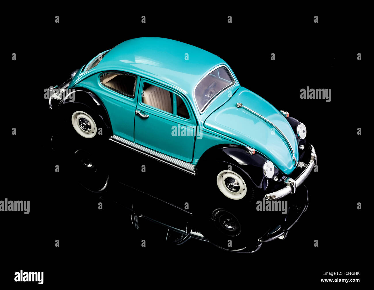 VW Beetle in Blue Die cast model on a white background. - Stock Image