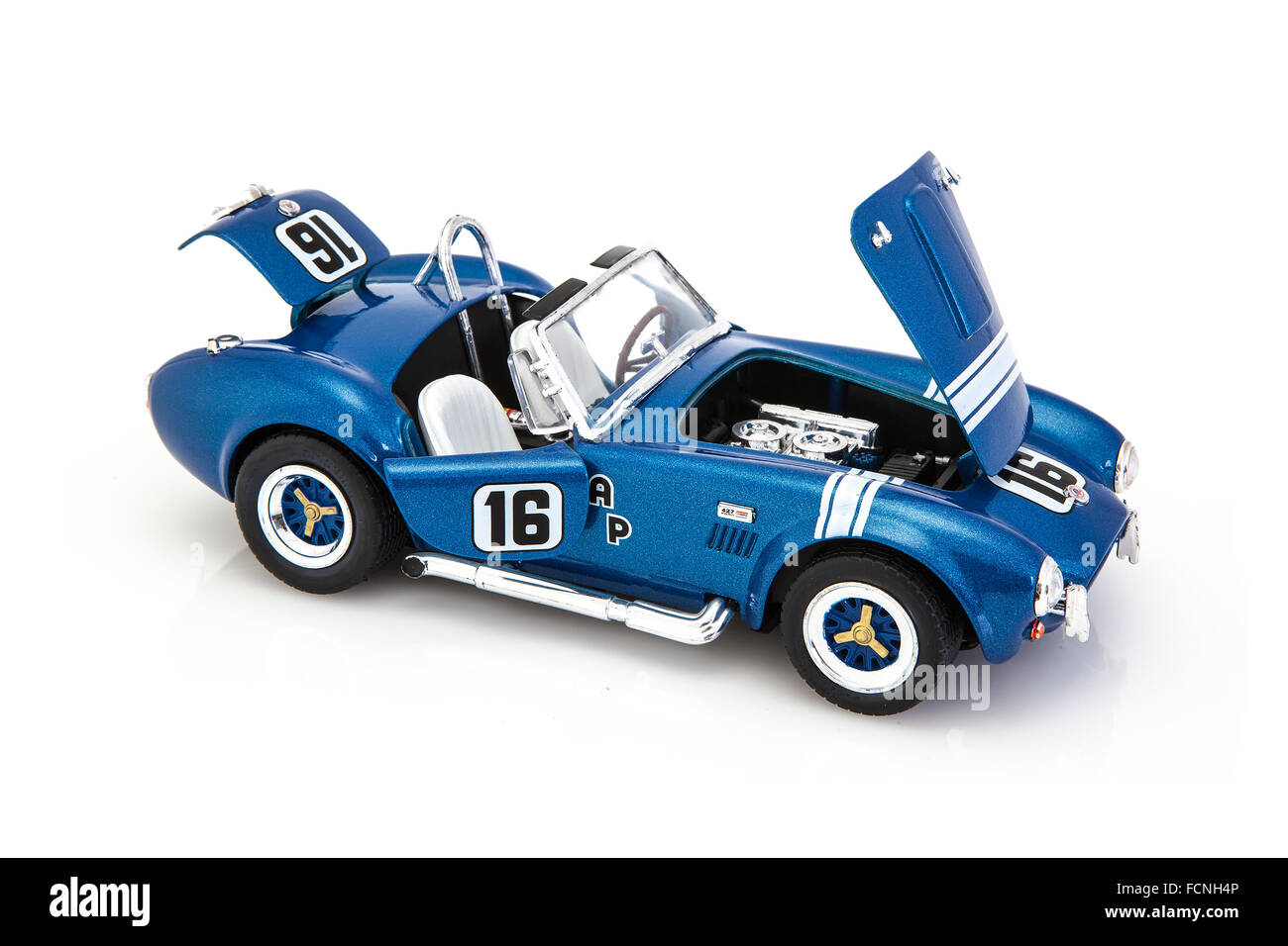 AC Cobra Coupe in racing trim on a white background fitted with a Ford 427 seven liter engine - Stock Image