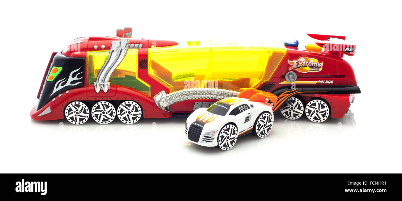 Extreme Model Racing Car And Transporter on a White Background - Stock Image