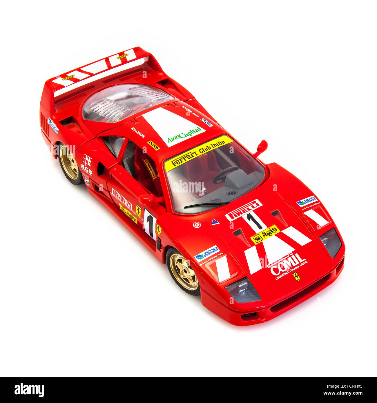 Red Ferrari F40 in race trim on a white background - Stock Image