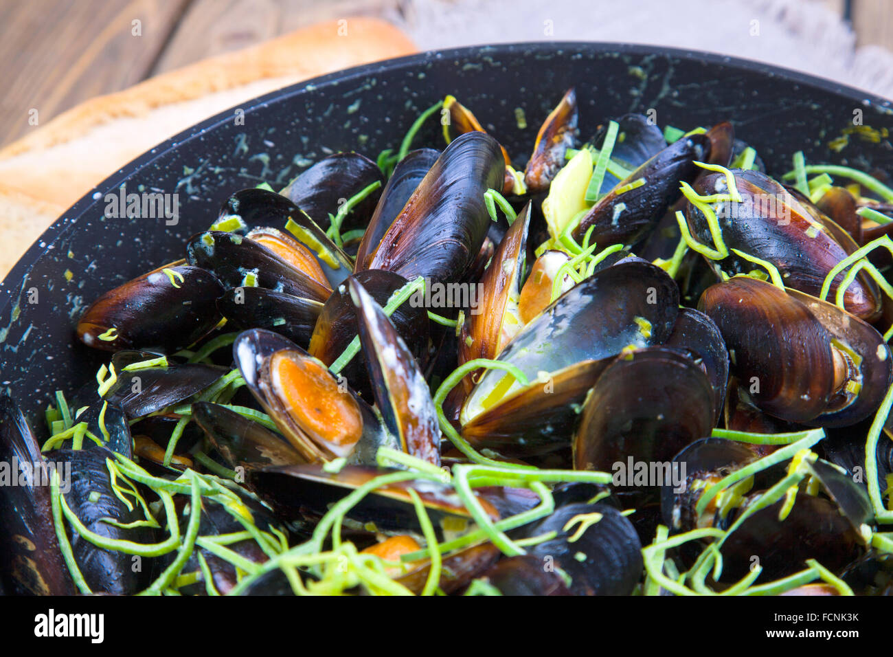 Mussels cooked in wine - Stock Image