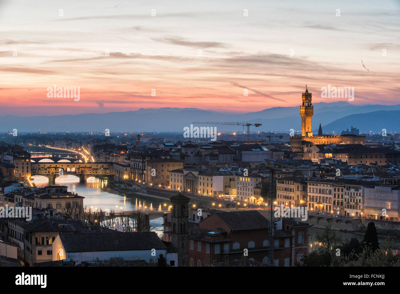 A picture postcard of Florence panorama just after sunset with the skyline of its famous monuments and River Arno - Stock Image