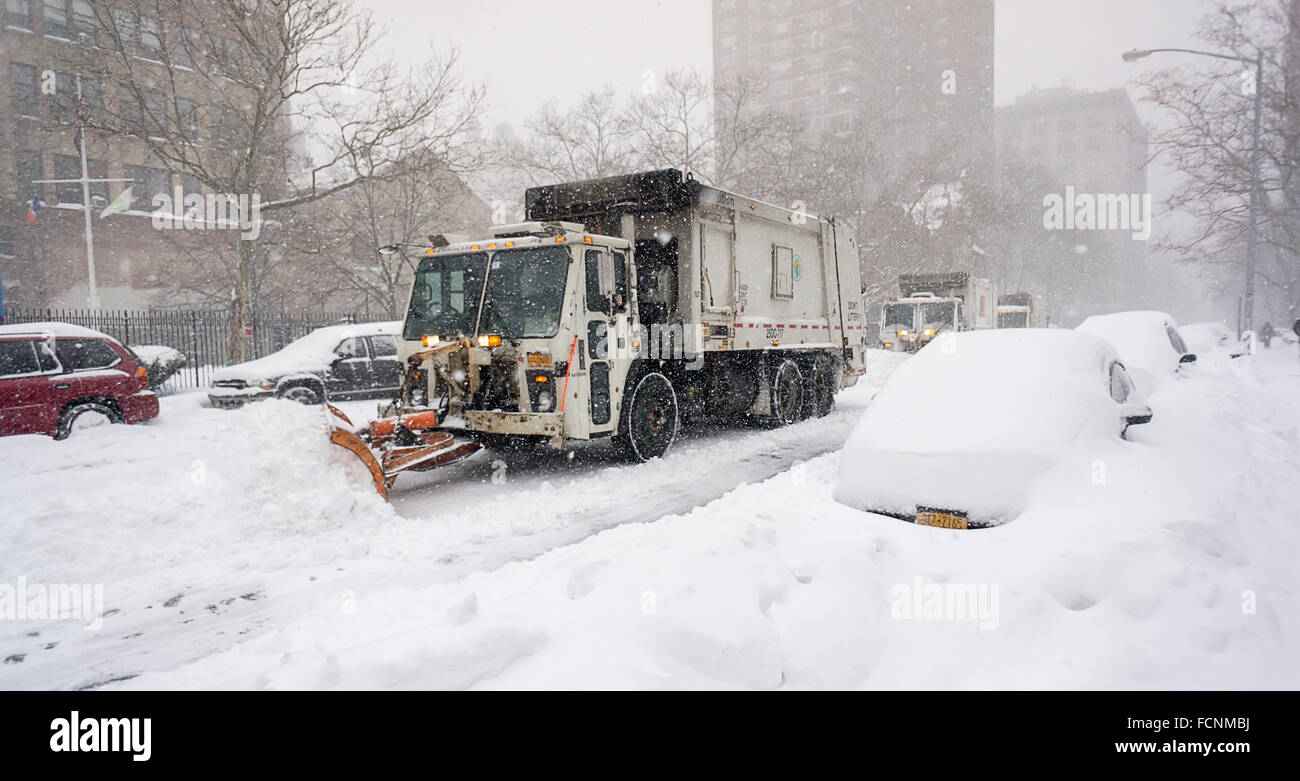 New York, USA. 23rd Jan, 2016. Dept. of Sanitation trucks plow West 26th Street, a secondary roadway, in Chelsea Stock Photo