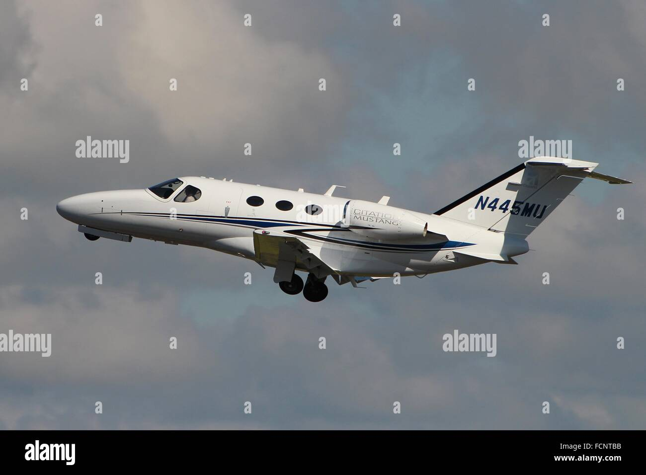 N445MU, a Cessna 510 Citation Mustang, departs from Glasgow Prestwick International Airport. Stock Photo