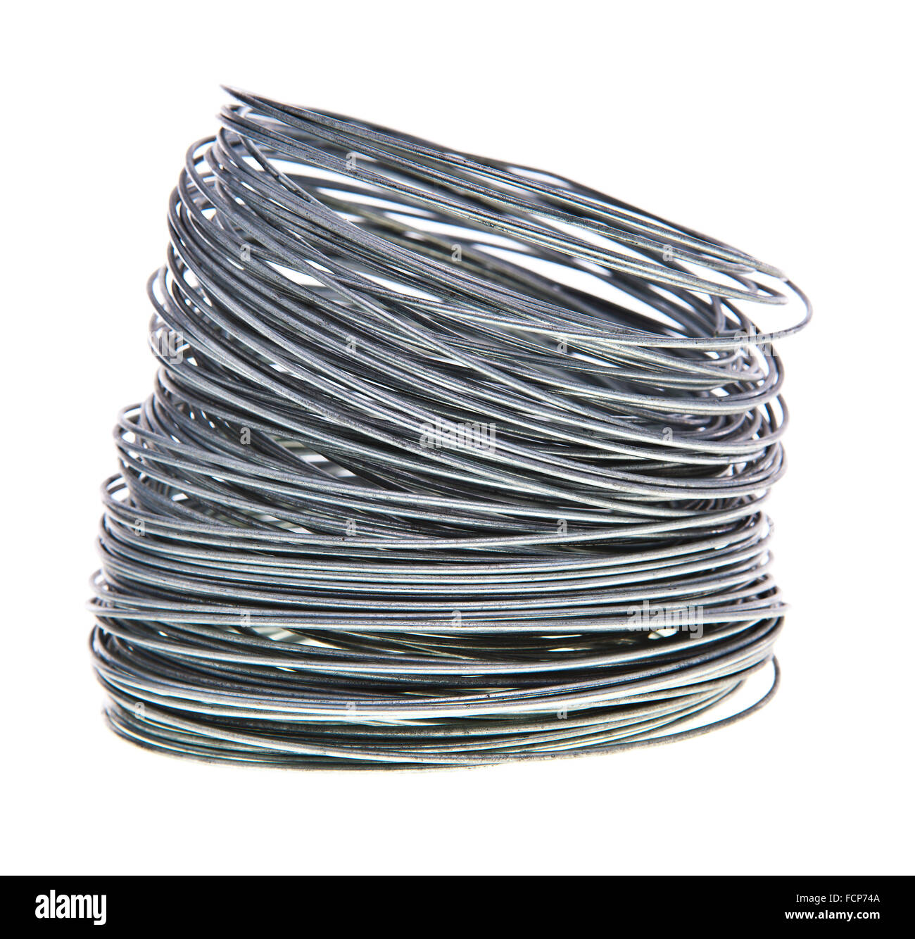 Coil of galvanized wires on white background - Stock Image
