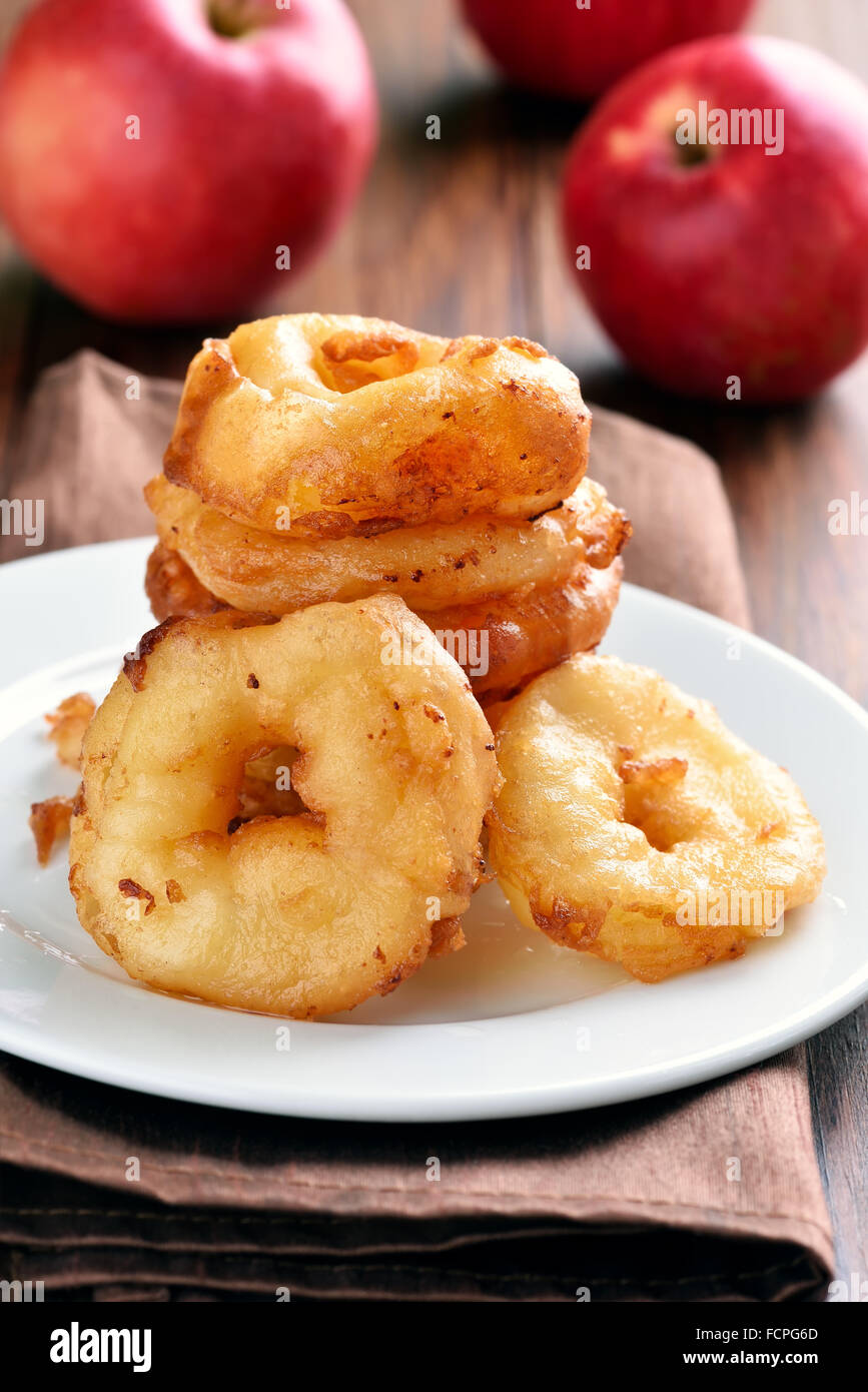 Apple doughnuts on white plate - Stock Image