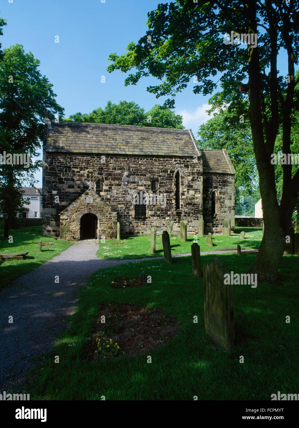 Looking NNE at C7th nave & chancel of Escomb Saxon (Anglian) church, County Durham, built of reused stones brought - Stock Image