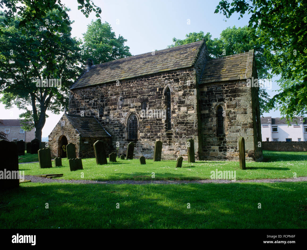 Looking NW at C7th nave & chancel of Escomb Saxon (Anglian) church, County Durham, built of reused stones brought - Stock Image