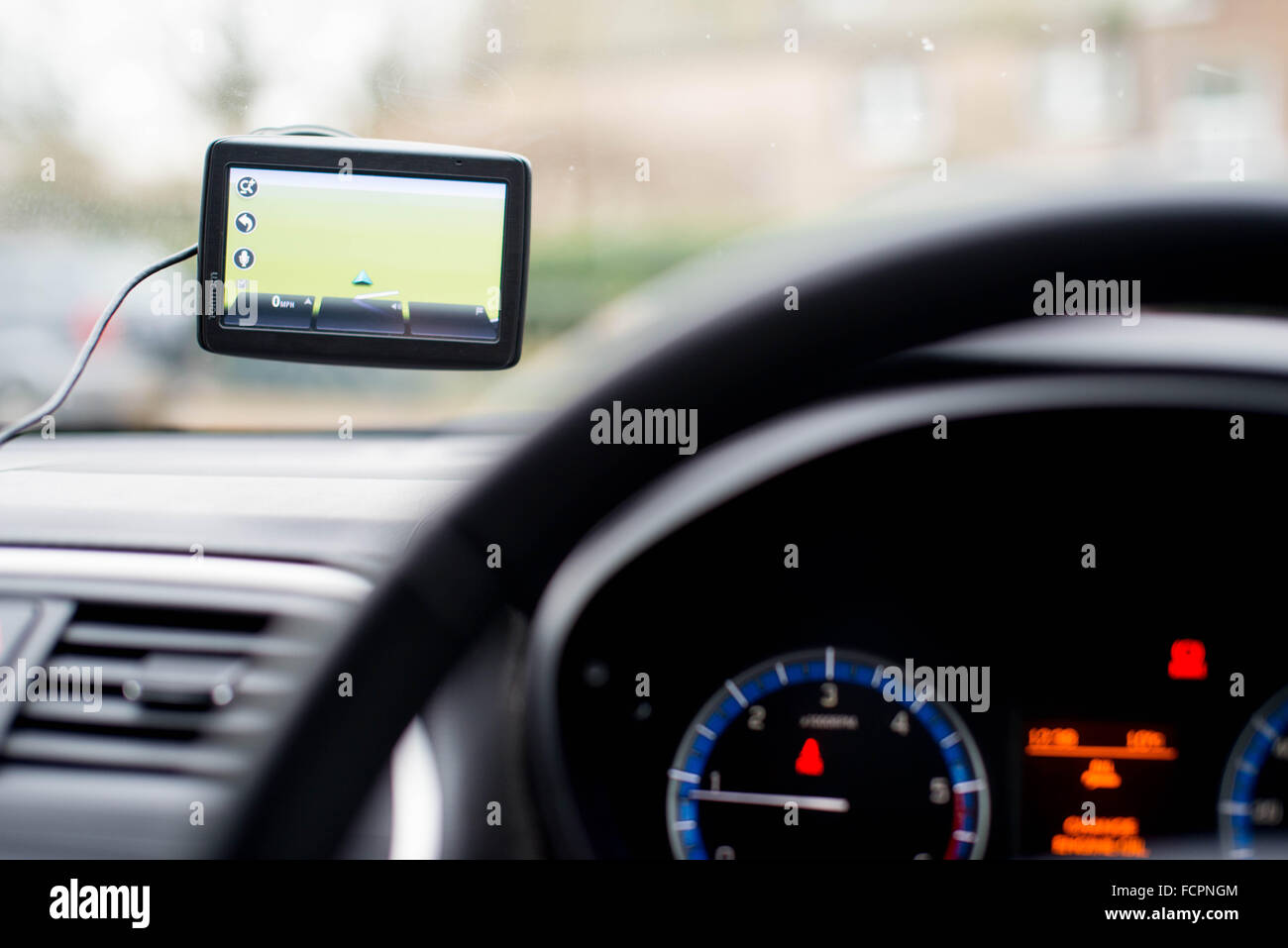 A 'tomtom' satellite navigation system (sat nav) or GPS set up in a car. - Stock Image