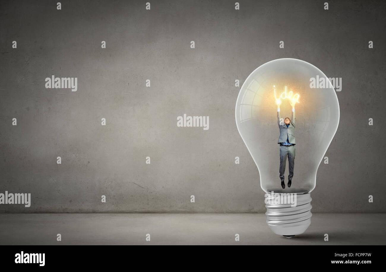 man holding luminous idea inside light bulb stock photo 93928125