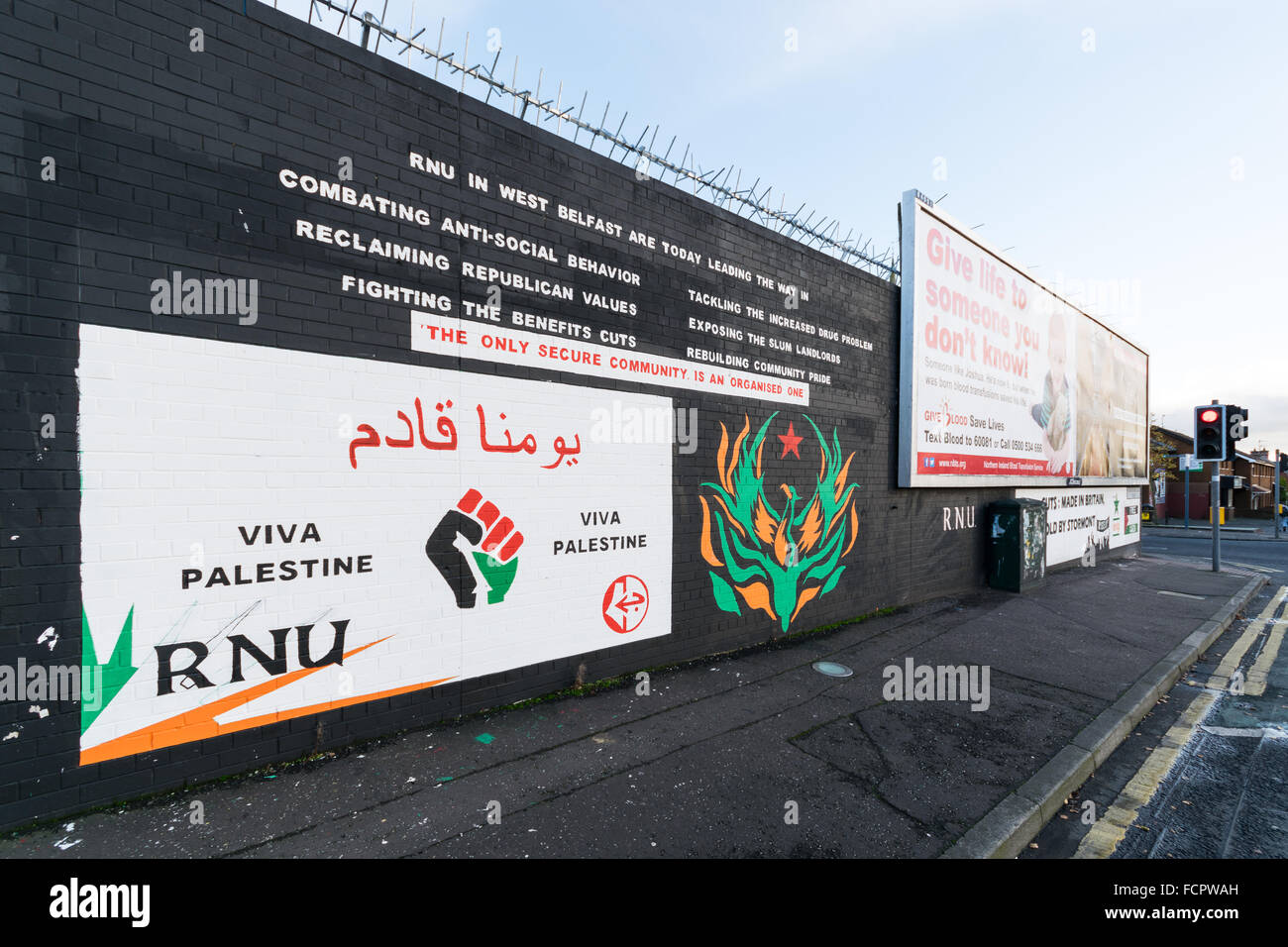 RNU mural at Belfast's Falls Road with Palestine solidarity message. - Stock Image
