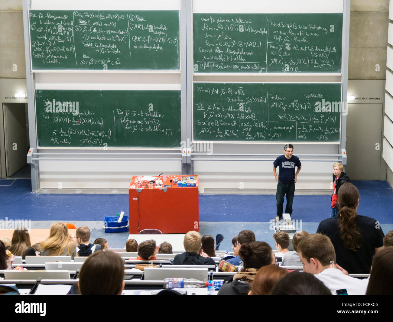 Blackboards full of scientific formulas during a lecture of higher mathematics at a university lecture auditorium. - Stock Image