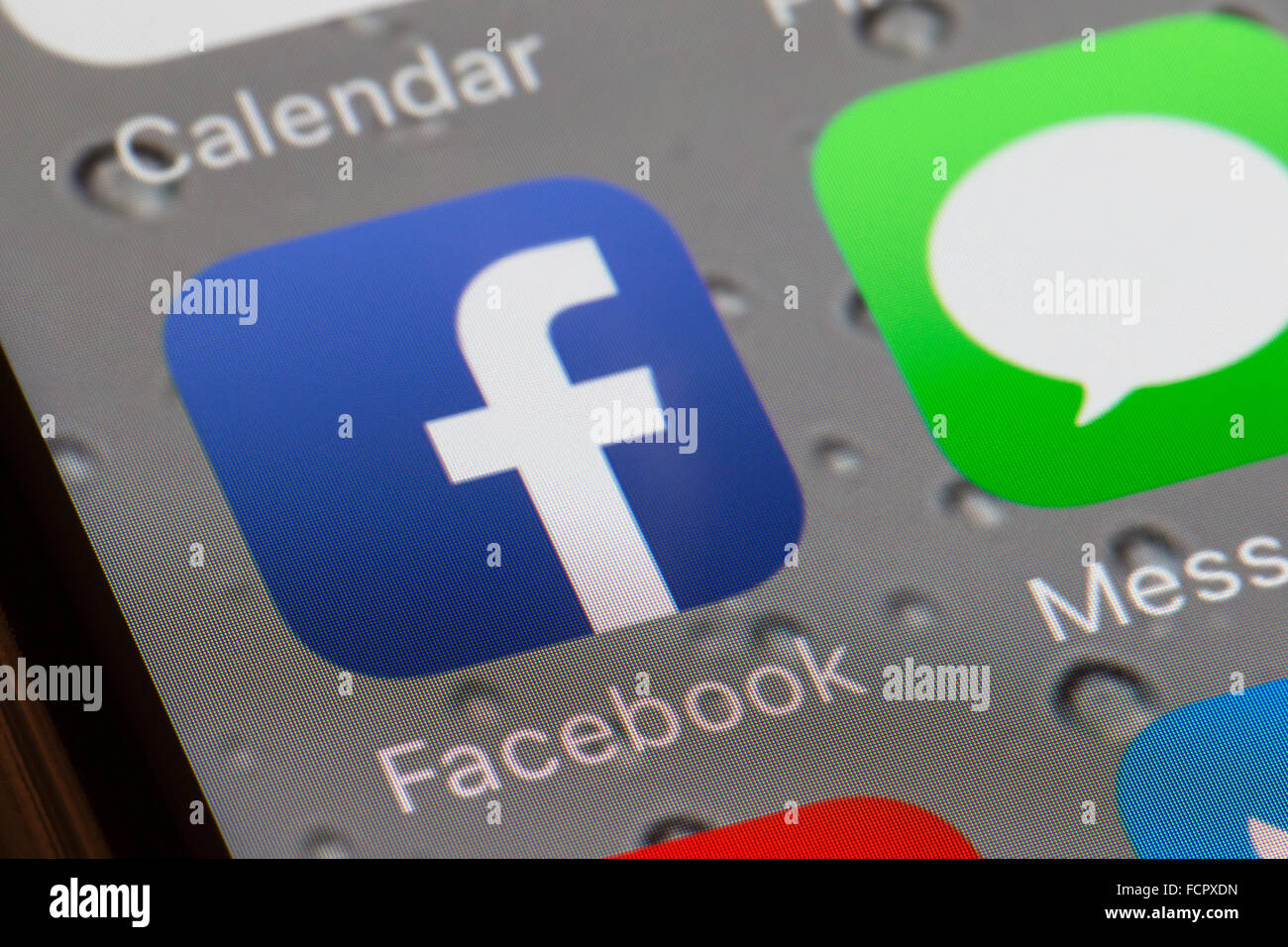 Facebook app icon on an iphone 6 screen - Stock Image
