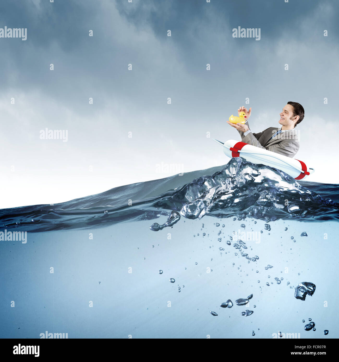 Funny businessman with yellow rubber duck toy Stock Photo