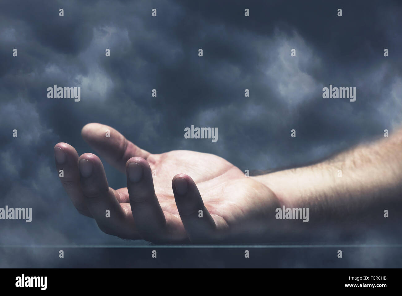 Human hand with cloud - Stock Image
