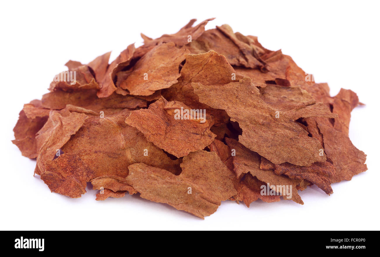 Pieces of dry tobacco leaves over white backgrouknd - Stock Image