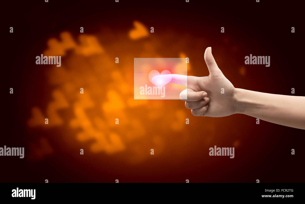 Close up of hand touching icon with finger - Stock Image