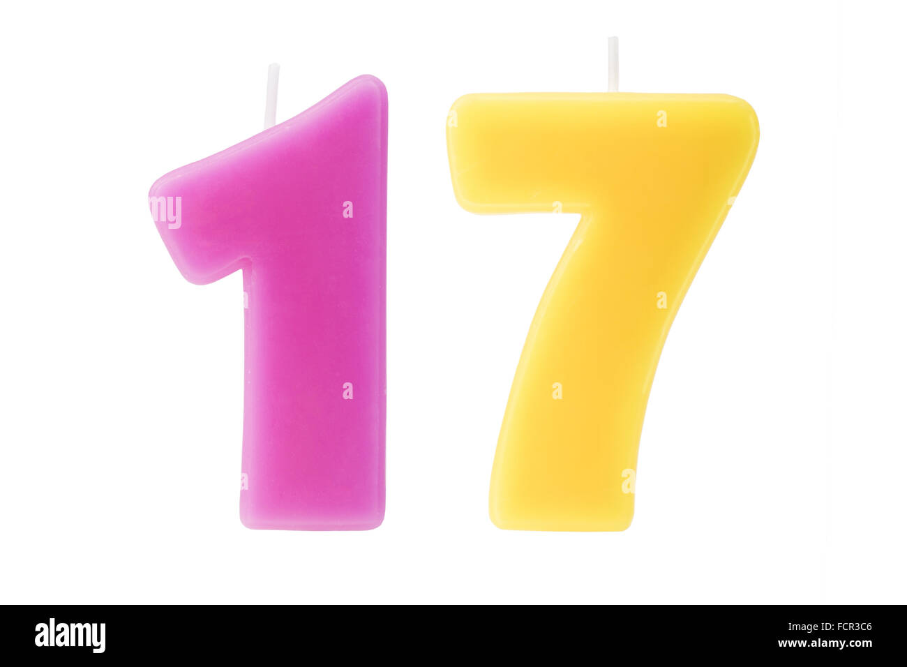 Colorful birthday candles in the form of the number seventeen on white background - Stock Image