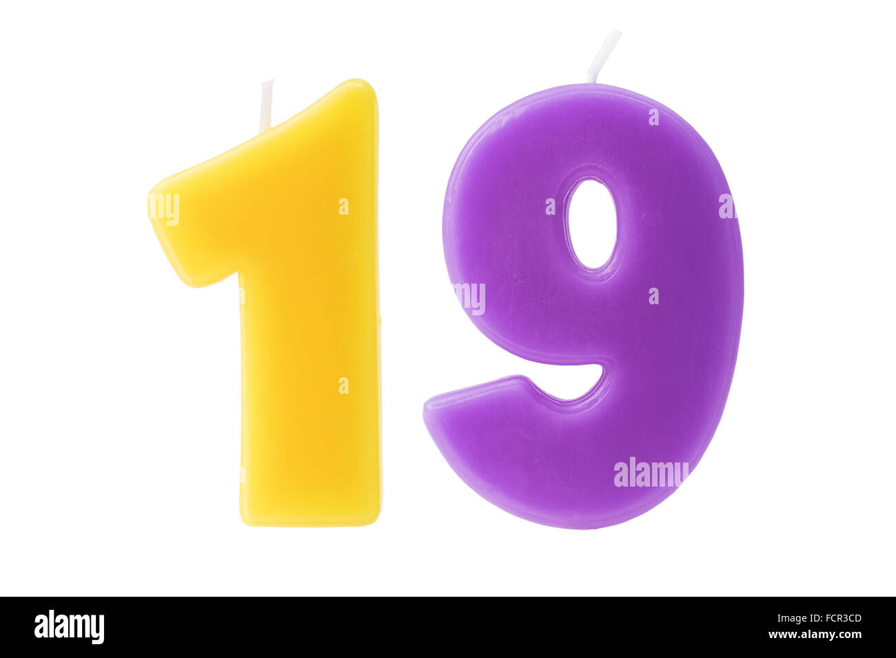 Colorful birthday candles in the form of the number nineteen on white background - Stock Image