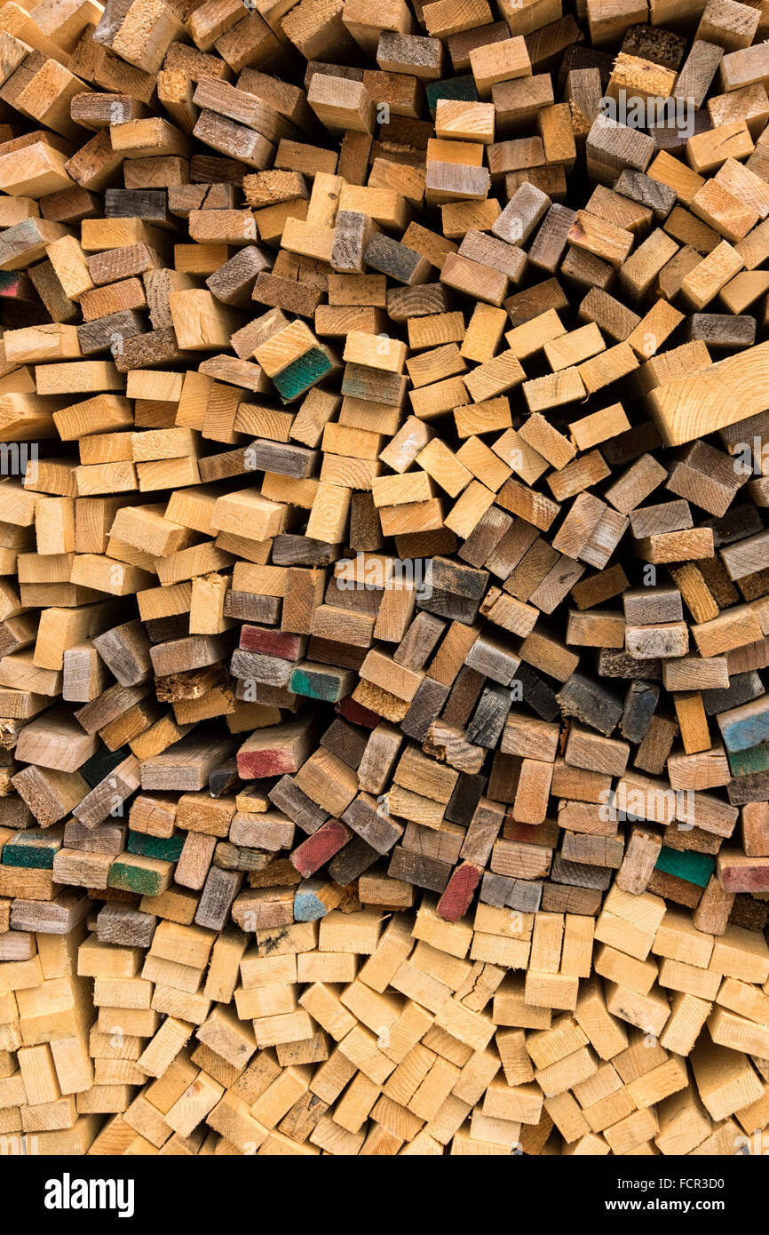 Trimmed and debarked timber planks piled up at a sawmill - Stock Image