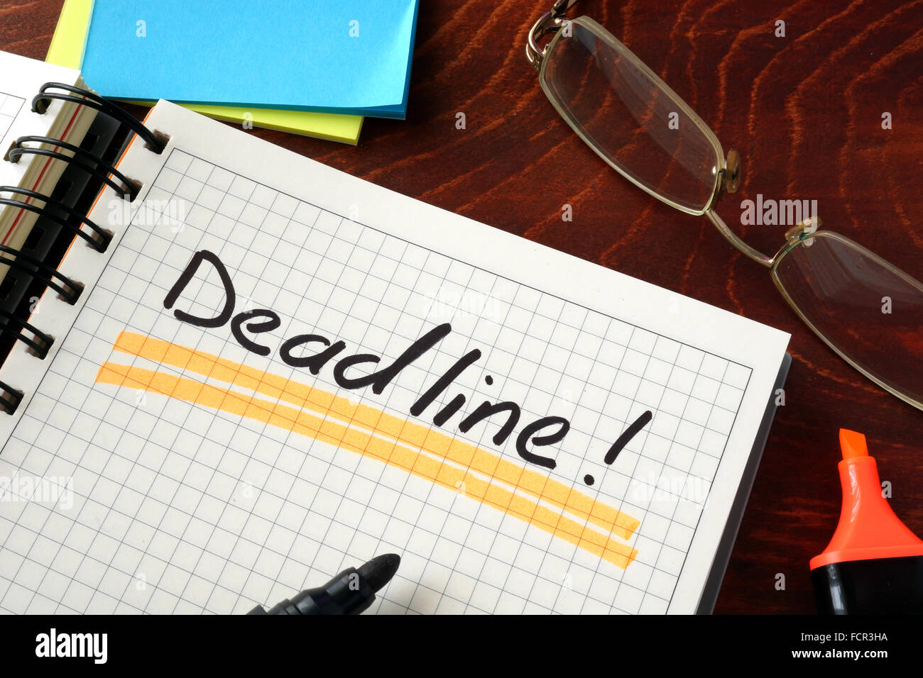 Notebook with  Deadline sign on a table. Business concept. - Stock Image