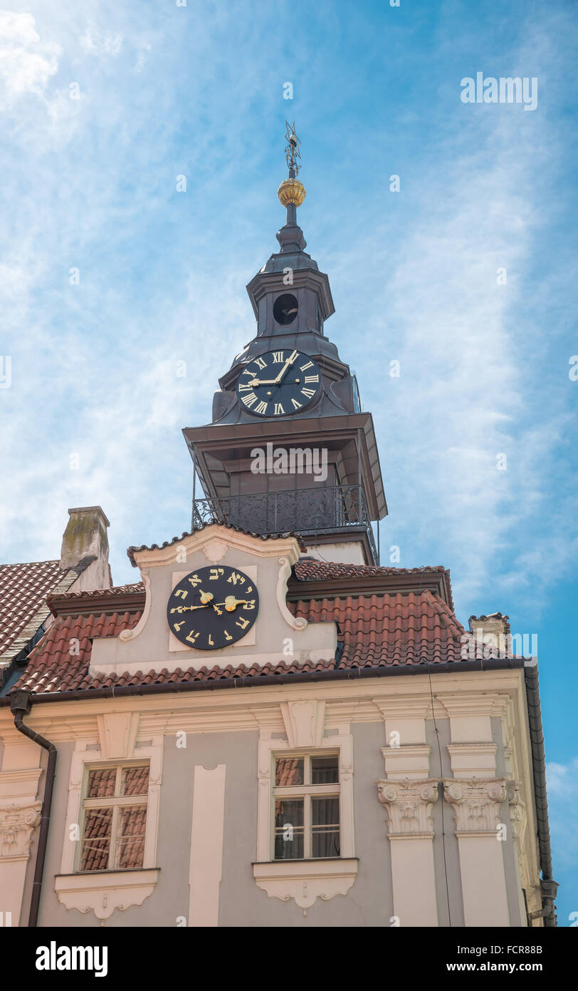 Tower of the Jewish Town Hall, with its clock whose hands turn counterclockwise, according to the Hebrew script. - Stock Image