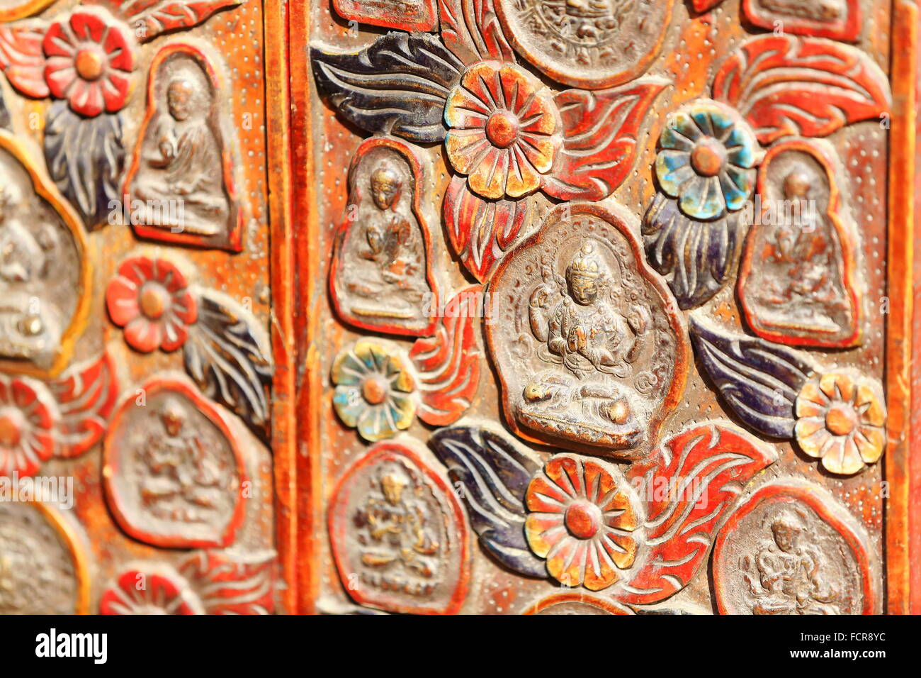 Traditional nepalese woodcarved folding screen exhibiting buddhist decoration for sale-windowshop of store-Kathmandu Stock Photo