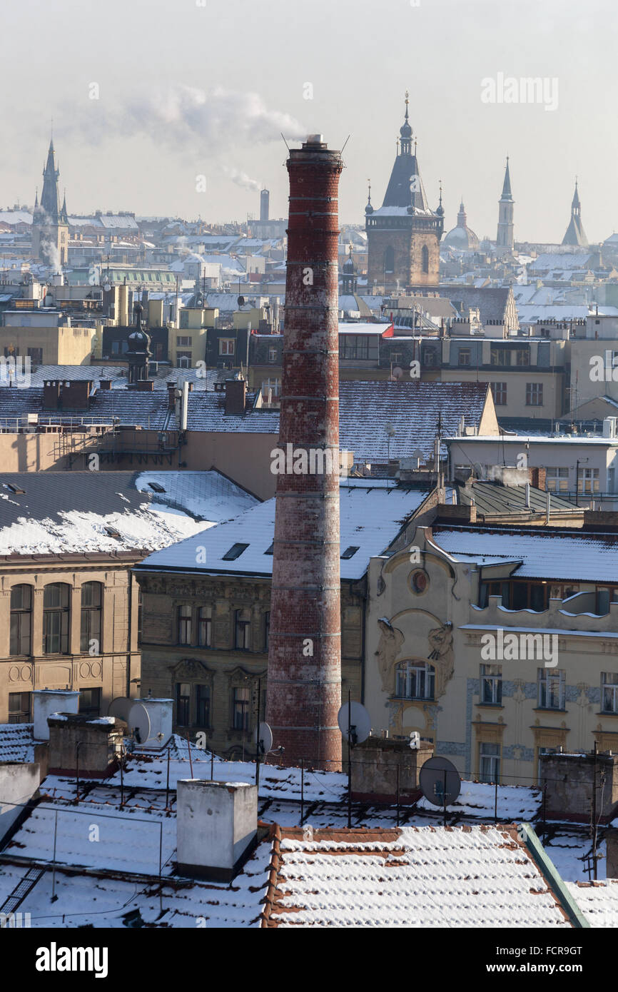 Still functional chimney in Old Town. In the background, New Town Hall, Prague, Czech Republic - Stock Image