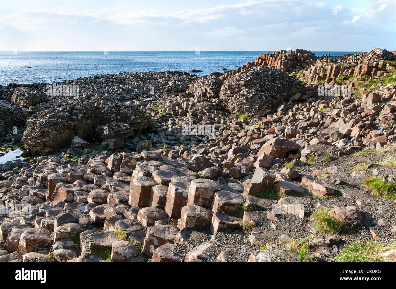Giants Causeway, unique geological formation of rocks and stones on the coast of Antrim County, Northern Ireland, - Stock Image