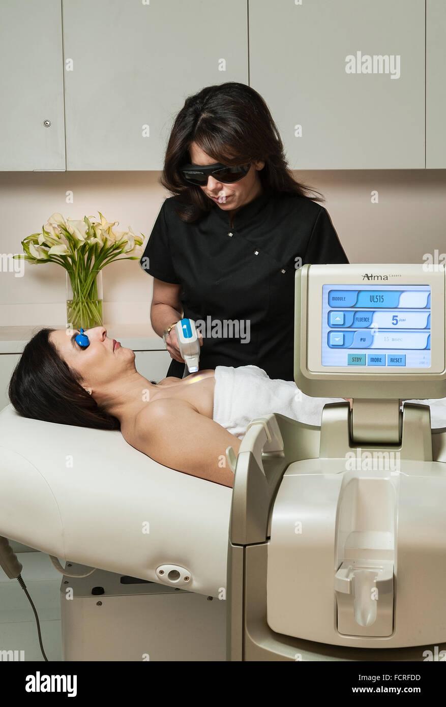 IPL, Intense Pulsed Laser Treatment for damaged skin. - Stock Image