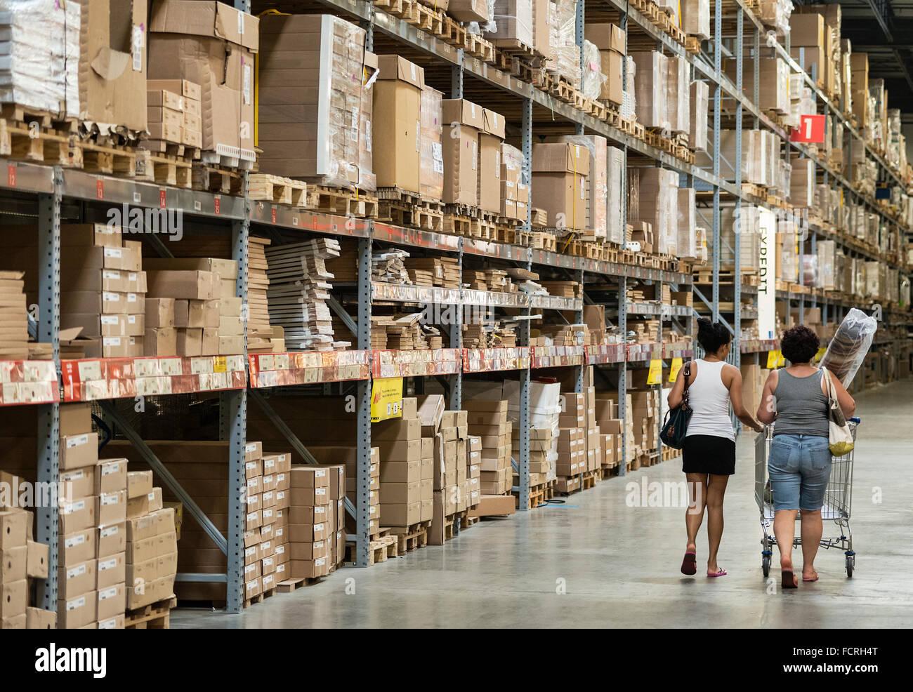 Warehouse storage of retail merchandise. - Stock Image