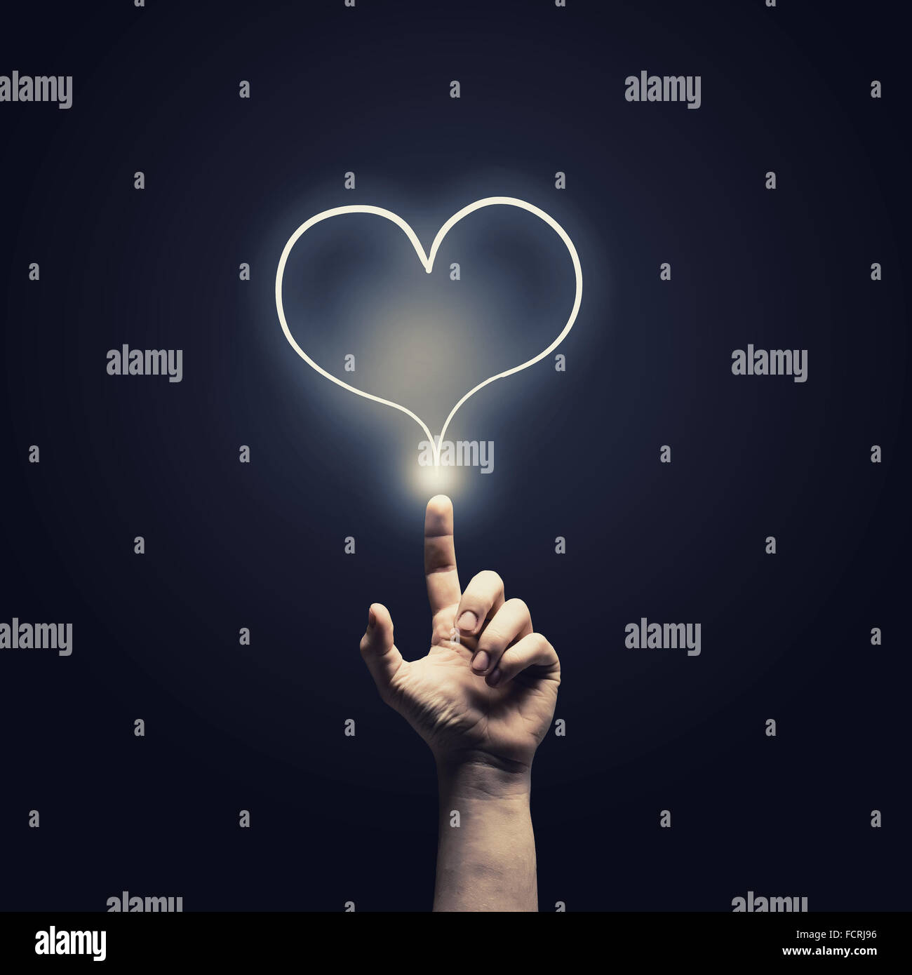 Male hand touch heart pulse on futuristic interface - Stock Image