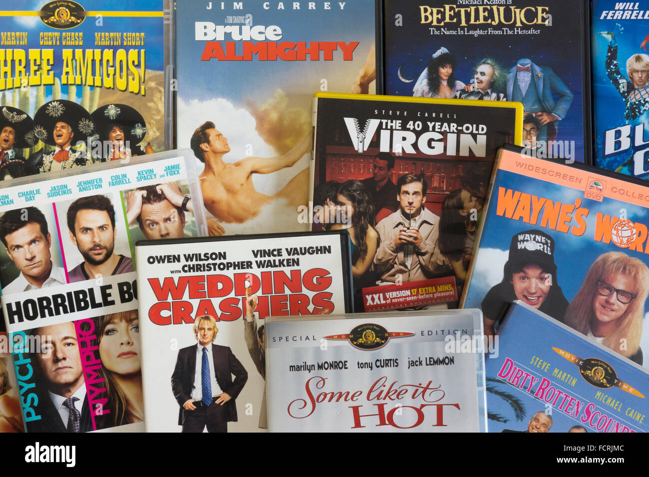 A collection of English language film DVDs showing the genre 'Comedy' - Stock Image