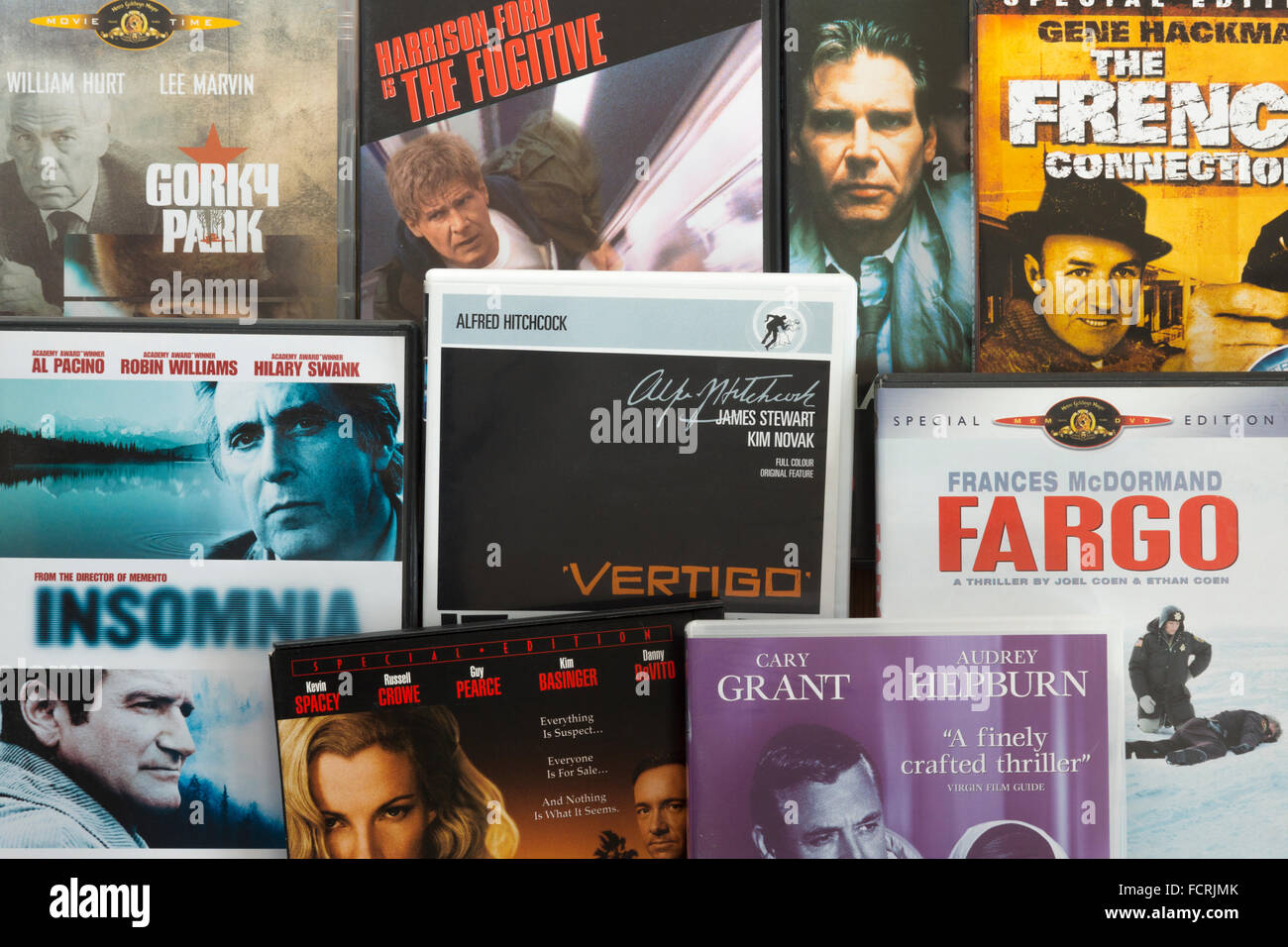 A collection of English language film DVDs showing the genre 'Thriller' - Stock Image