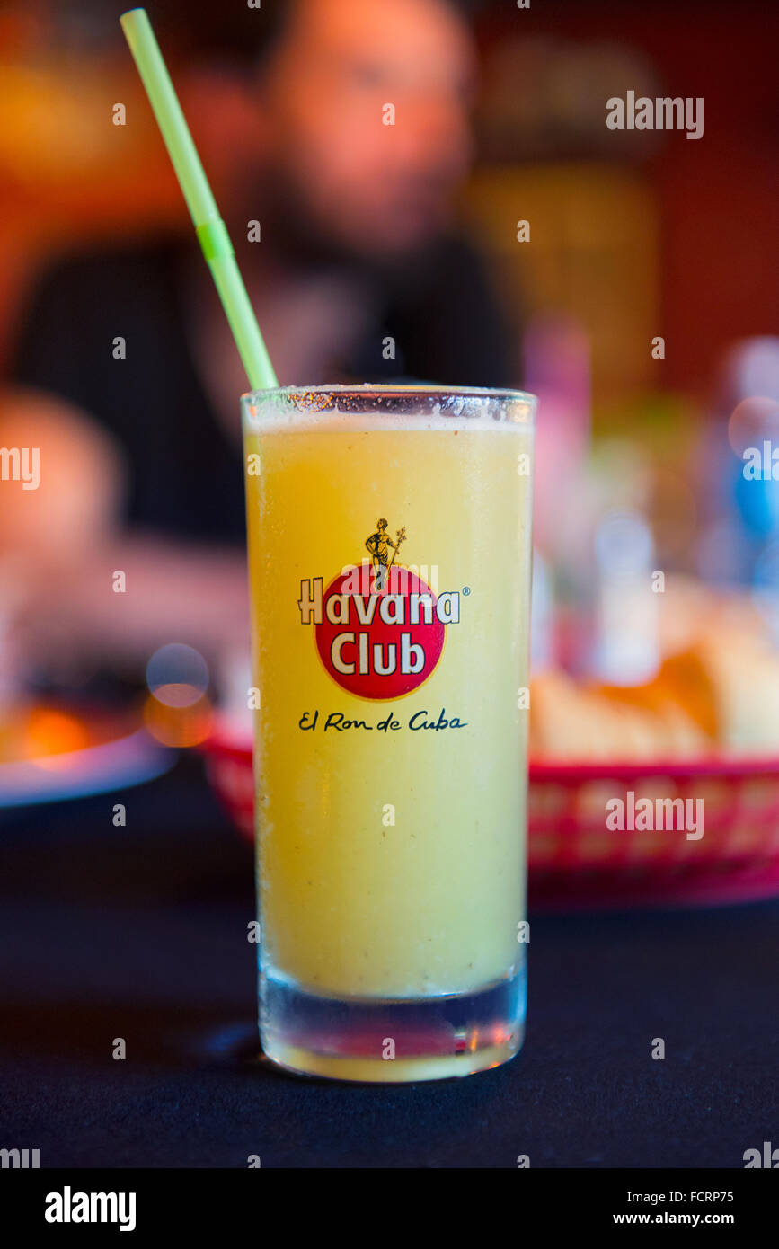 Havana Club, El Ron del Cuba, Cocktail in Glass with Straw Rum - Stock Image