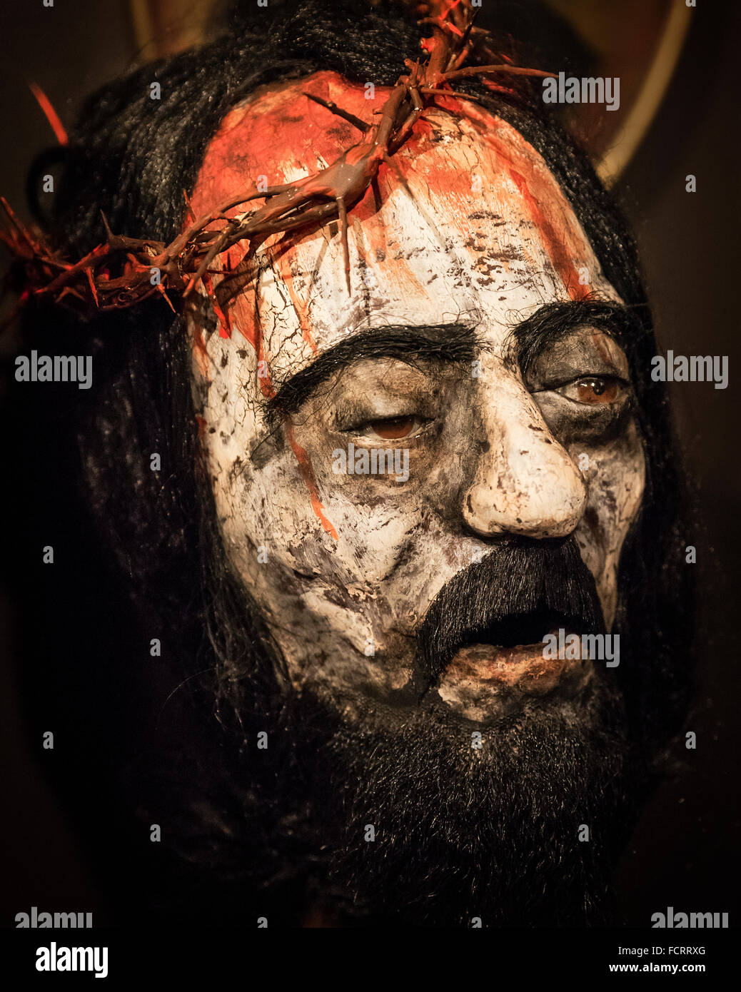 The Passion of Christ figure with crown of thorns. - Stock Image