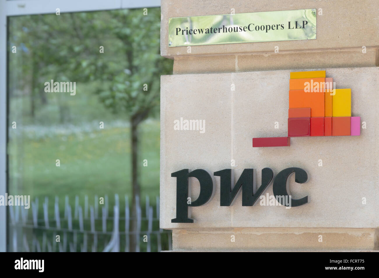 The PWC logo on the side of their building. - Stock Image