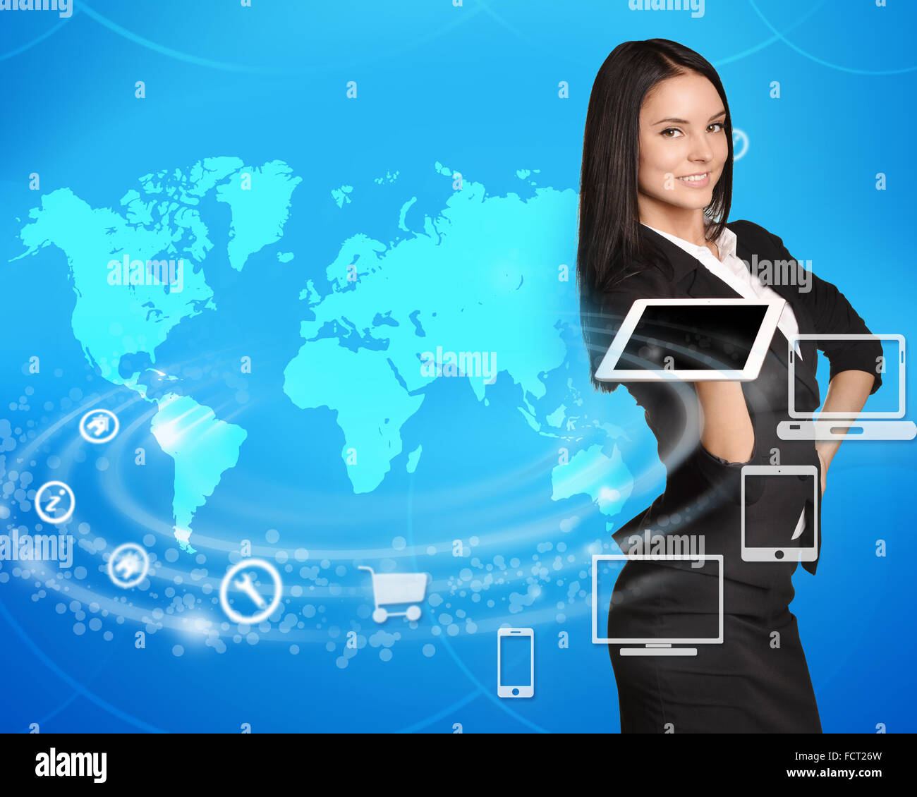 Business woman standing with tablet in hand on world map background - Stock Image
