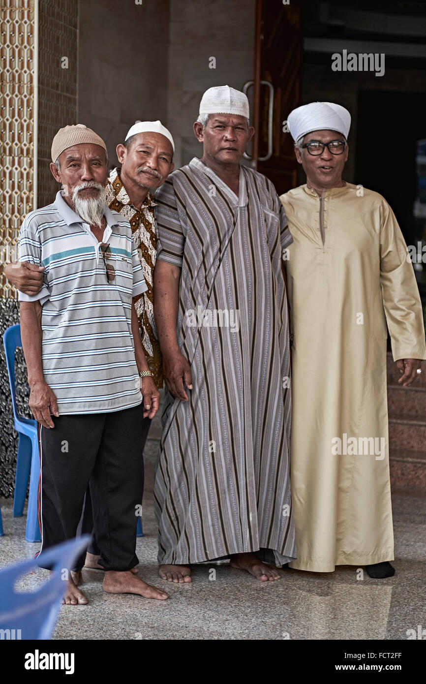 Muslim elders in varying dress code. Thailand S. E. Asia - Stock Image
