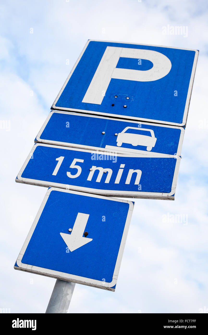 Parking road signs over cloudy sky background in Finland Stock Photo