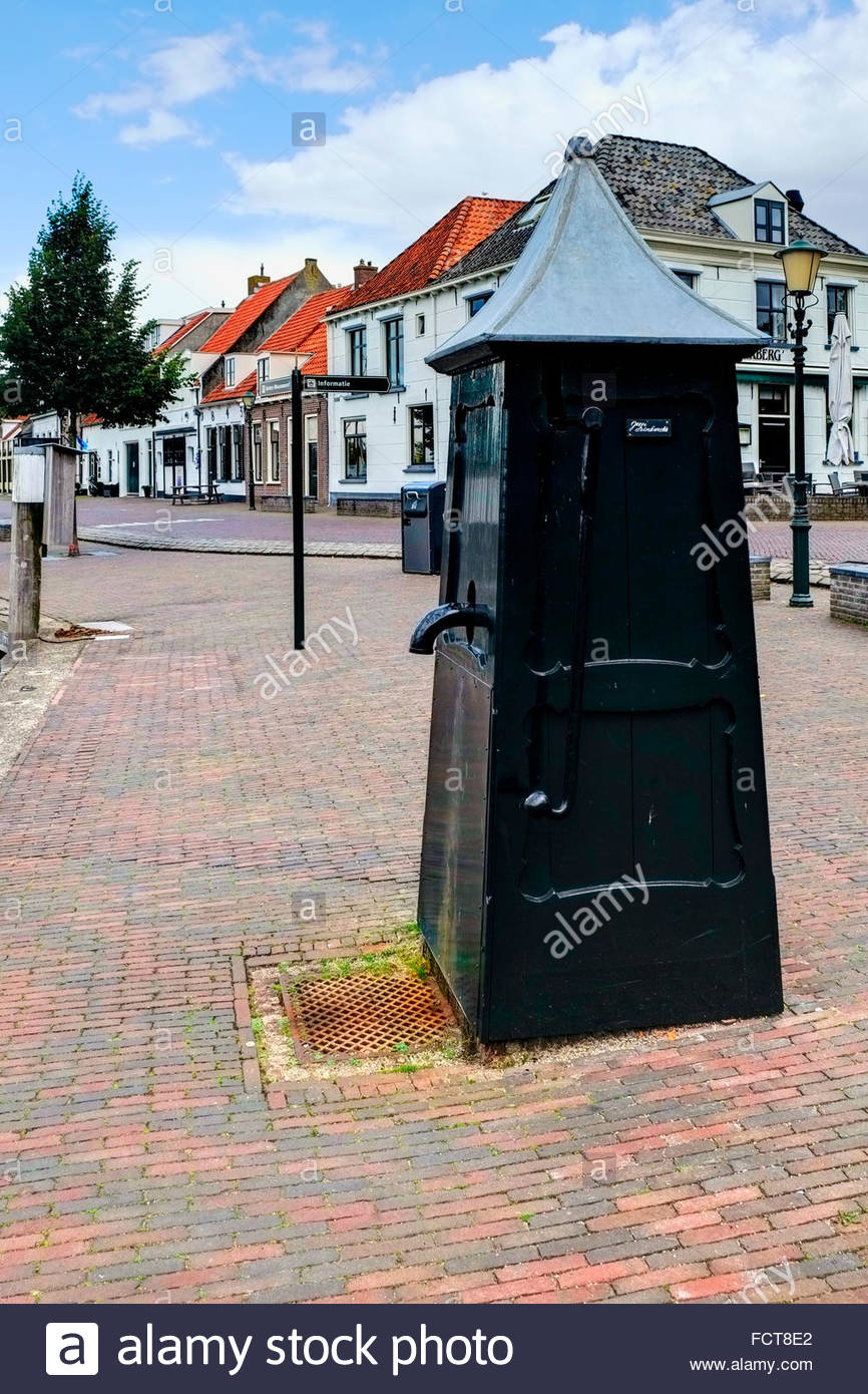 Pump for non-potable water on the dock at Elburg's harbor on the Drontermeer, Gelderland, The Netherlands. - Stock Image