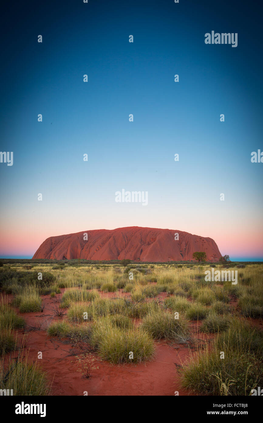 Majestic Uluru at sunset on a clear winter's evening in the Northern Territory, Australia - Stock Image