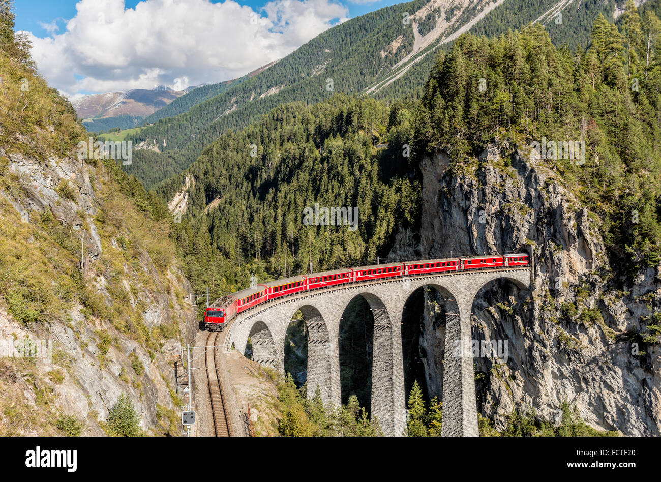 Glacier Express at the Landwasser Viaduct at Swiss Alps, Switzerland | Glacier Express auf Landwasser Viadukt, Schweiz - Stock Image