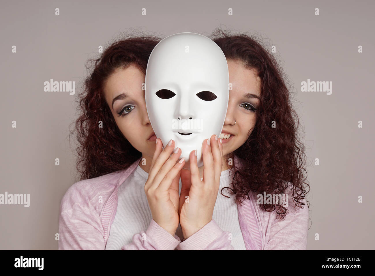 two-faced woman manic depression concept Stock Photo
