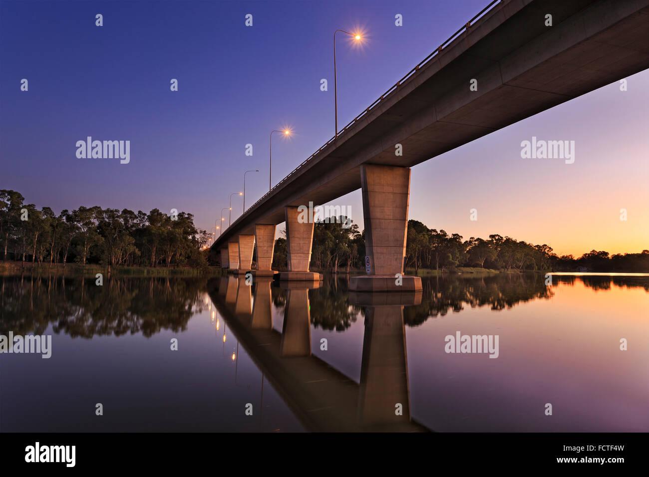 Modern tall bridge over Murray river near Mildura as a boundary between NSW and VIC in Australia at sunrise Stock Photo