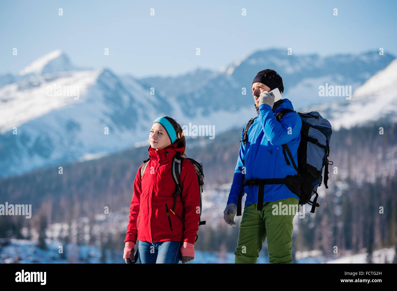 Young couple on a hike - Stock Image