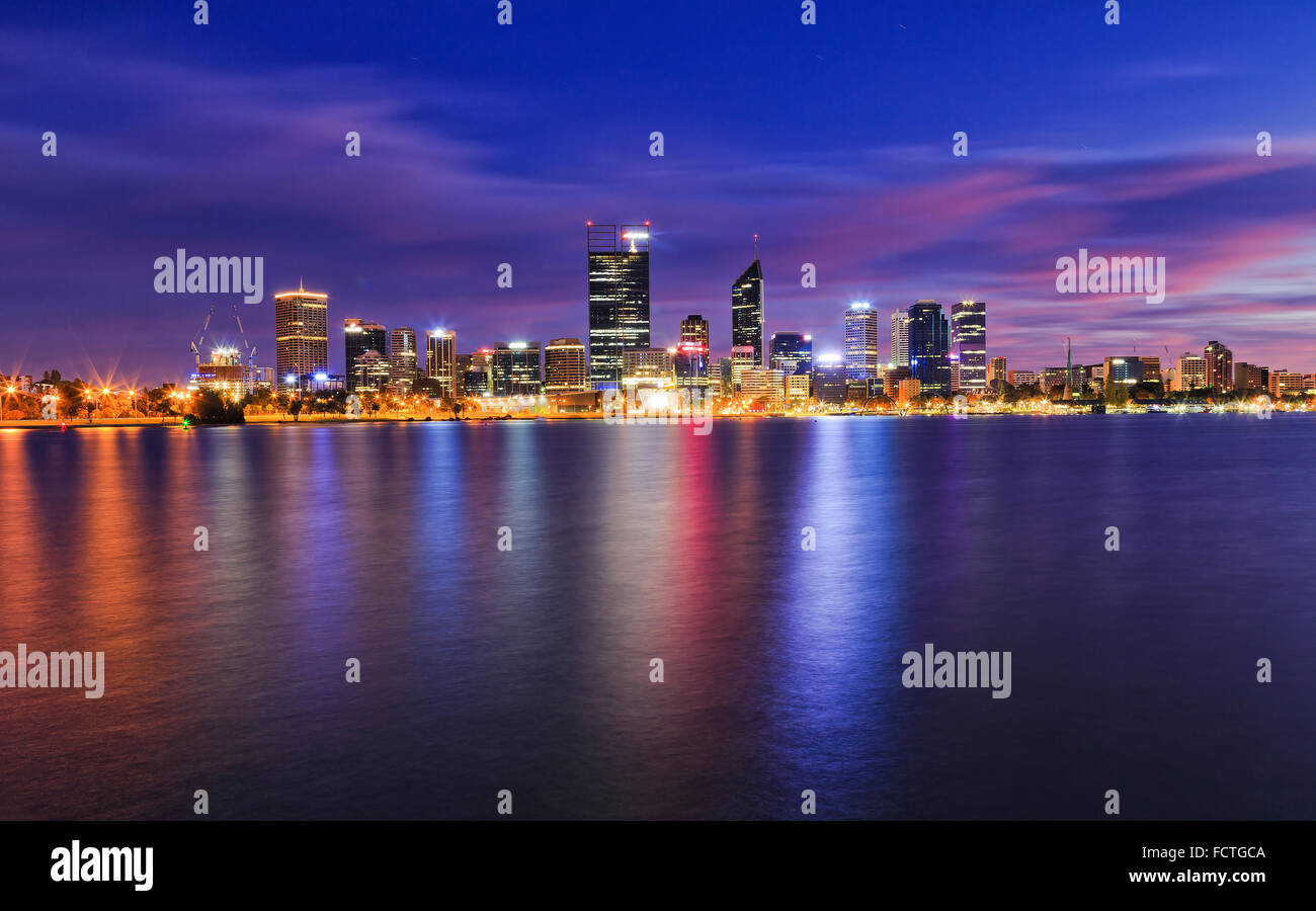 Western Australia capital city Perth CBD at sunrise reflecting in still waters of swan river - Stock Image