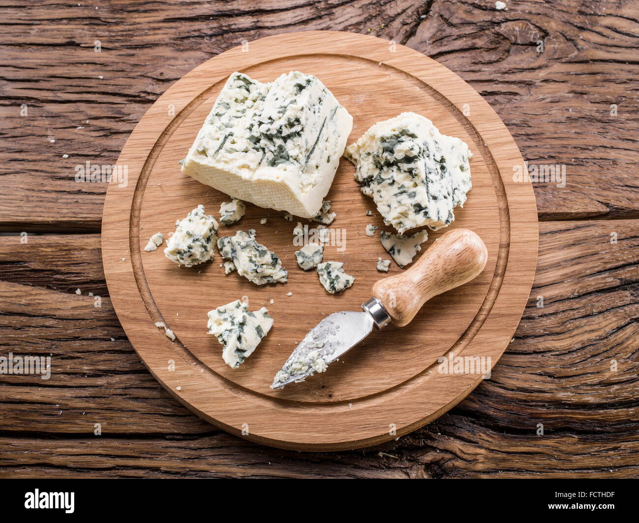 Danish blue cheese on a wooden board. Stock Photo