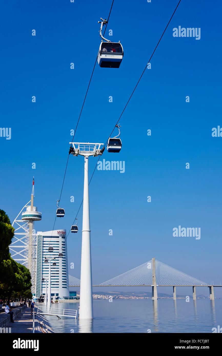 Portugal, Lisbon, Vasco da Gama bridge, the longest bridge of Europe, and Tower or Torre Vasco da Gama, cable car - Stock Image