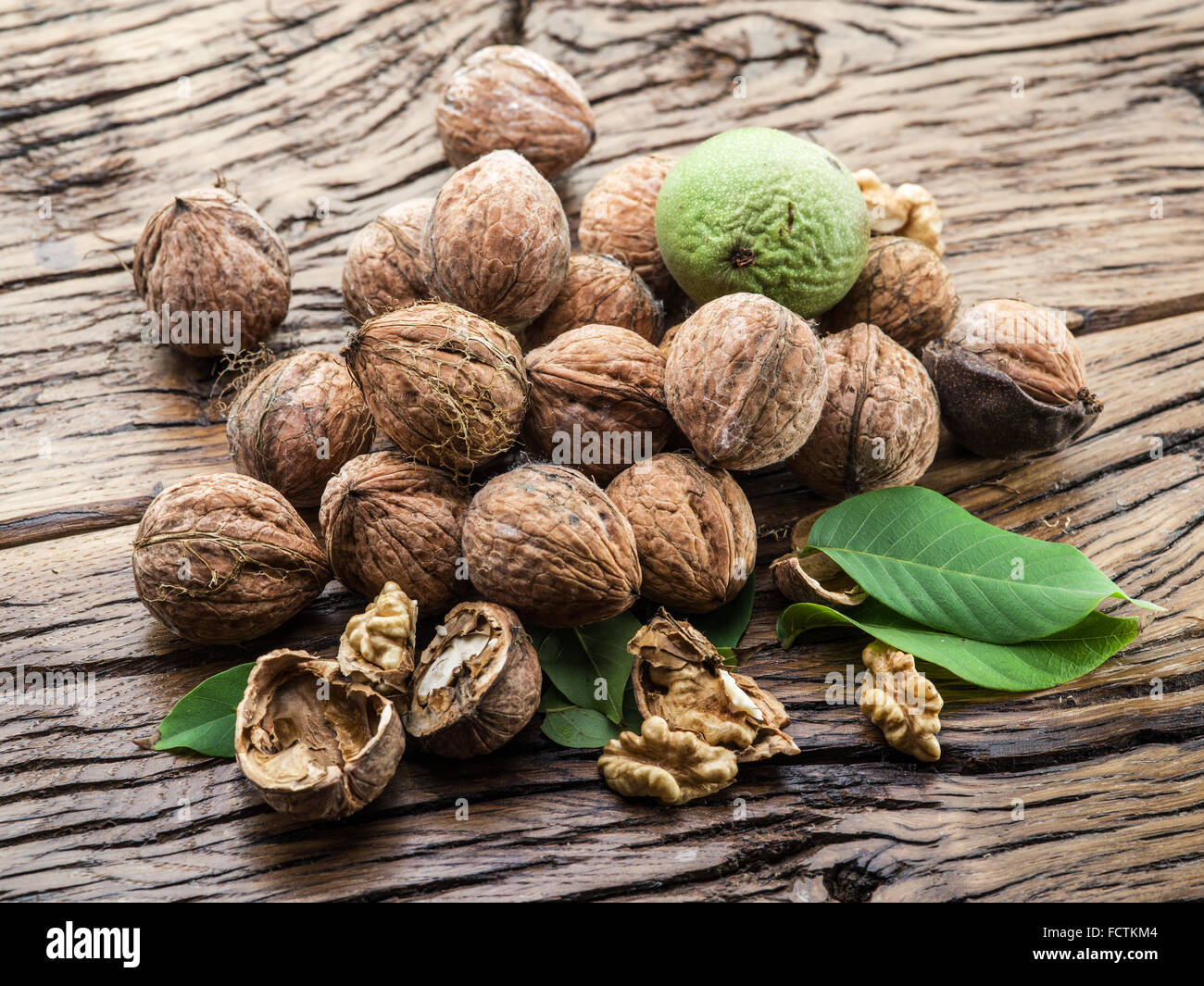 Walnuts on the wooden table. The autumn harvest. - Stock Image